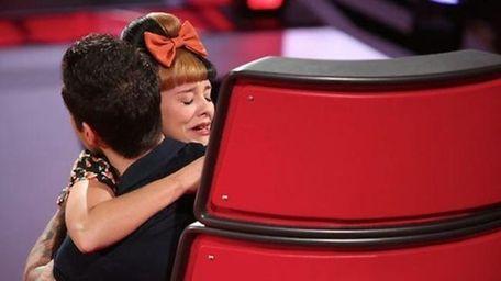 Baldwin's Melanie Martinez hugs coach Adam Levine on