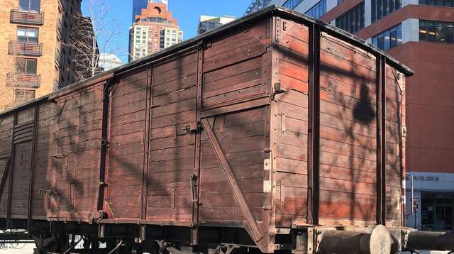 A windowless German freight car similar to those