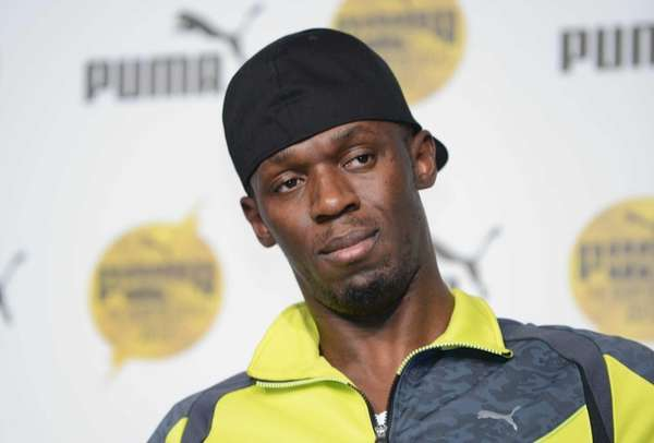 Olympic gold medalist Usain Bolt attends a press