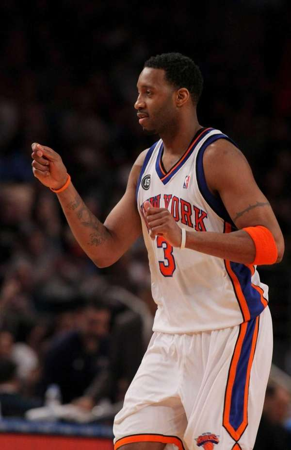 Tracy McGrady celebrates after scoring against the Oklahoma