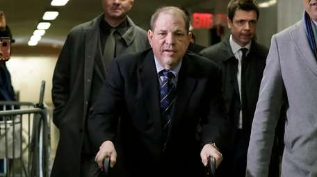 Harvey Weinstein arrives at court for his rape