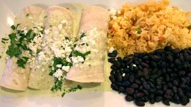 Enchiladas suizas with rice and beans at Cebolline's,