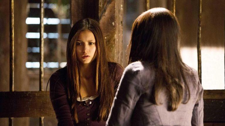 Nina Dobrev as Elena and Kat Graham as