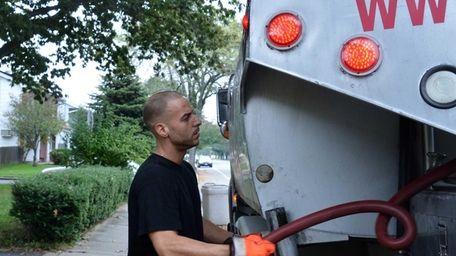 Nick Morfovasilis secures the hose and gun on