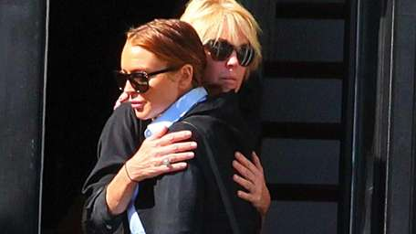 Lindsay and Dina Lohan share a hug outside
