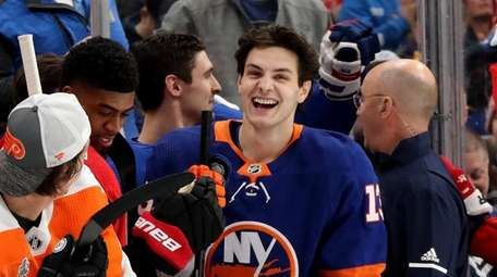 Mathew Barzal #13 of the Islanders reacts after