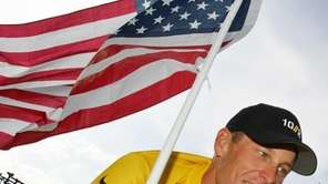 Lance Armstrong, of Austin, Texas, carries the United