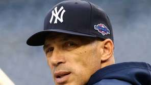 Joe Girardi looks on as his team warms