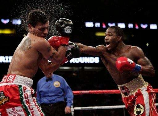 Adrien Broner lands a punch on Daniel Ponce