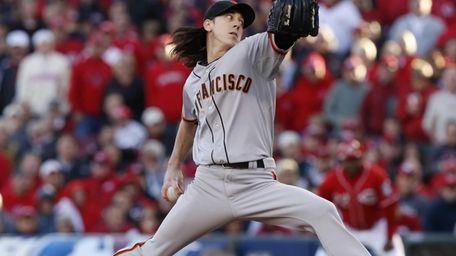 San Francisco Giants pitcher Tim Lincecum delivers a