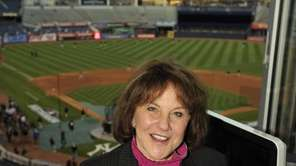 Suzyn Waldman, Yankees radio broadcaster, stands above the