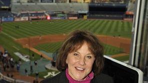 Suzyn Waldman, Yankees radio broadcaster, stands above the
