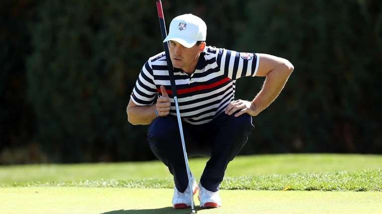 Keegan Bradley lines up a putt during the