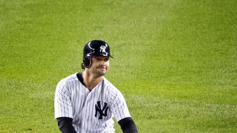 Nick Swisher reacts after being called out at