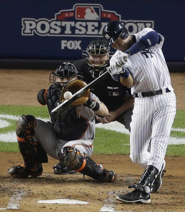 Derek Jeter hits an RBI triple during the