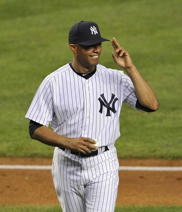 Mariano Rivera salutes the fans after throwing out