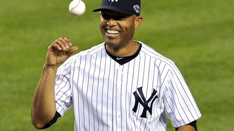 Mariano Rivera playfully flips the ball after throwing