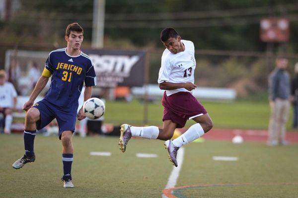Garden City junior Joseph Torres kicks the ball