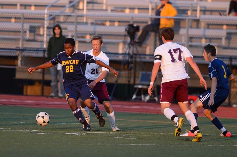 Jericho senior Ajani Motta takes the ball against