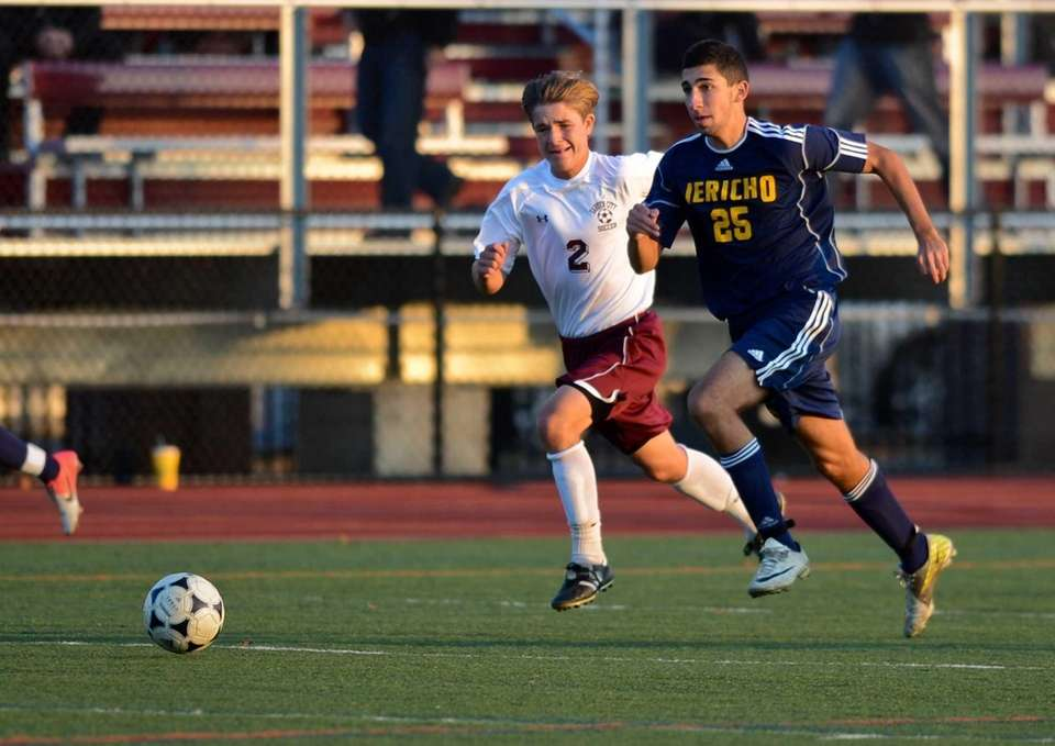 Jericho senior Brian Lowenstein takes the ball against