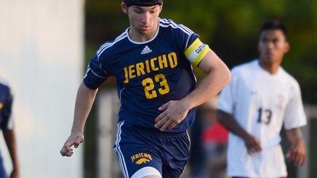 Jericho senior Harrison Reiber takes the ball against