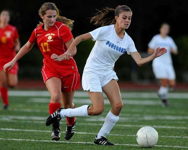Kellenberg's Christina Akalski, right, gets pressured by Sacred