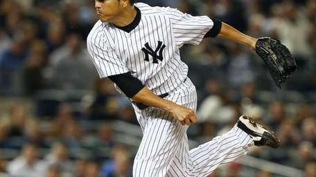 Hiroki Kuroda delivers a pitch against the Baltimore