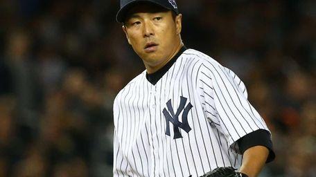 Hiroki Kuroda looks on during against the Baltimore