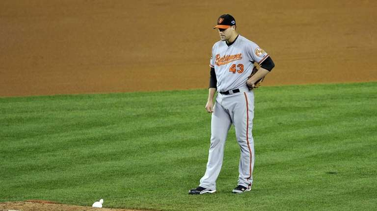 Orioles relief pitcher Jim Johnson appears stunned after