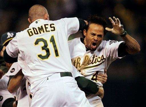 Oakland Athletics left fielder Coco Crisp celebrates after