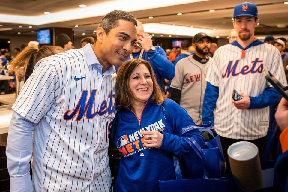 Mets manager Luis Rojas takes a picture with