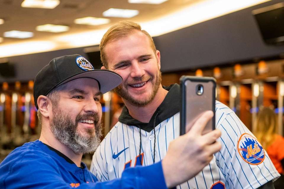 New York Mets Pete Alonso greets James Hadden