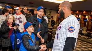 Fans walk around in the Mets' clubhouse, get