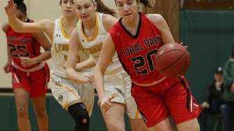 Floral Park's Erin Harkins proceeds up court ahead