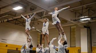 Cheerleaders from Riverhead High School participate in the
