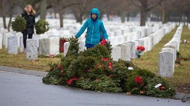 Volunteers pick up wreaths at Long Island National