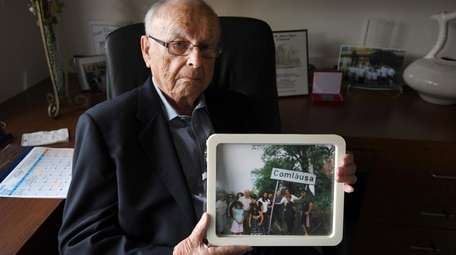 Jack Rosenthal with a photo of his family