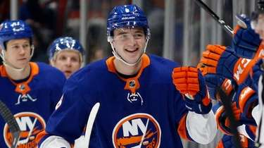Noah Dobson of the Islanders celebrates his second