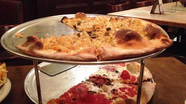 Clam pizza (top) and