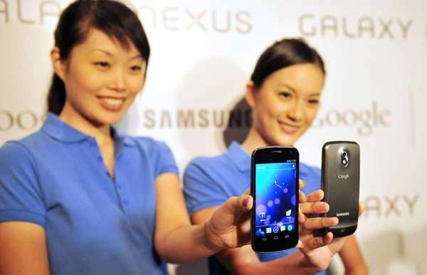 Models hold the new Samsung Galaxy Nexus Android