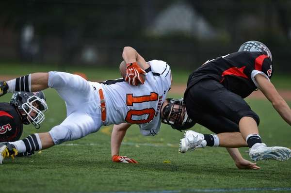 Babylon's Eric Schweitzer runs the ball during a