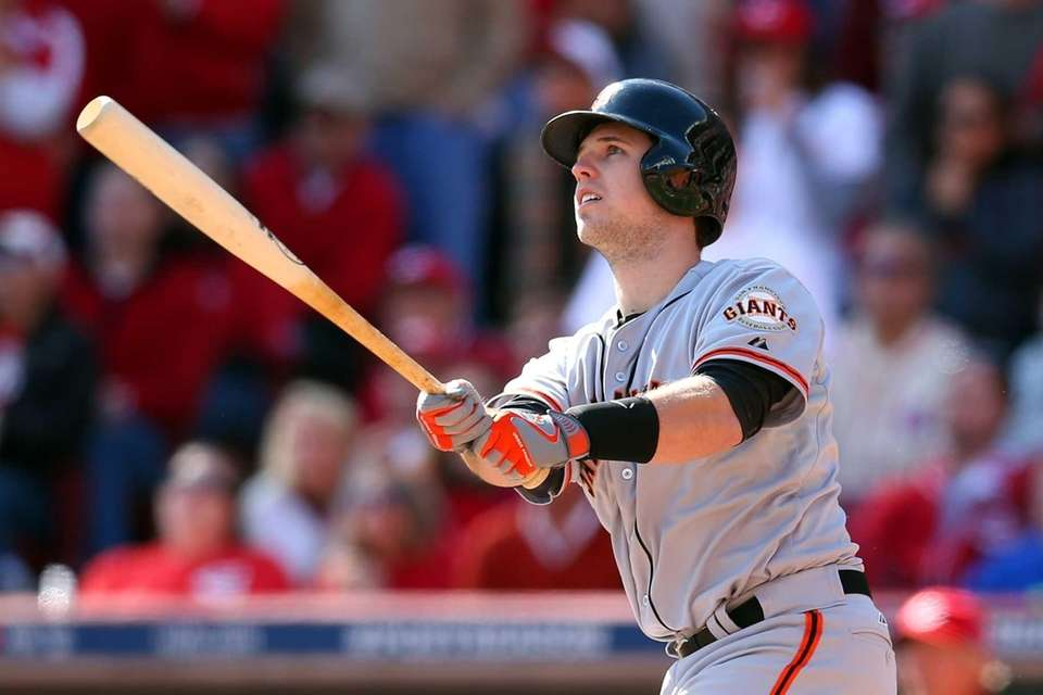 Buster Posey of the San Francisco Giants hits