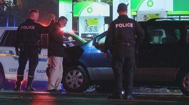 Suffolk police investigate the scene Saturday night on