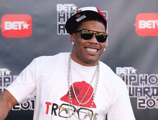Nelly arrives for the BET Hip Hop Awards
