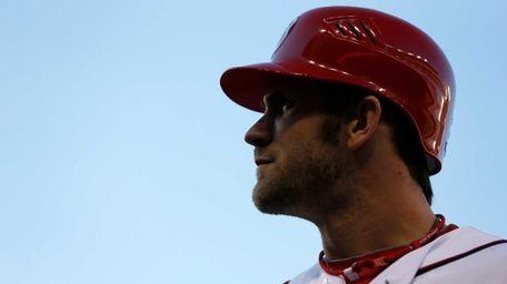 Washington Nationals outfielder Bryce Harper walks back to