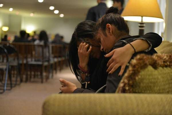 Aneika Sohan, right, and Dhewika Singh, 22, try