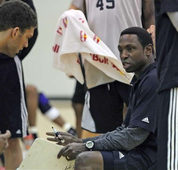 Nets head coach, Avery Johnson talks to players
