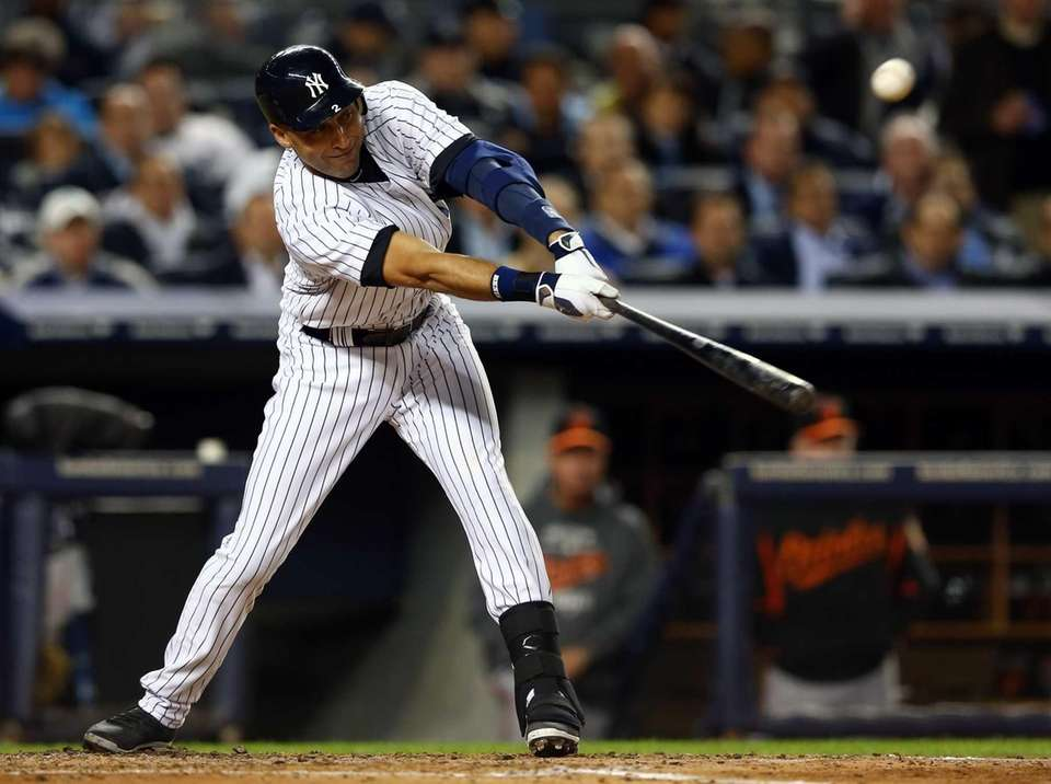 Derek Jeter bats during Game 4 of the