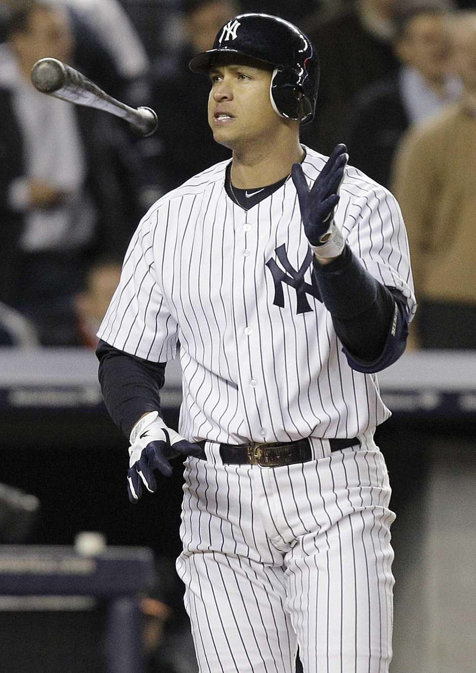 Alex Rodriguez tosses his bat after striking out