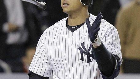 Alex Rodriguez tosses his bat after striking out